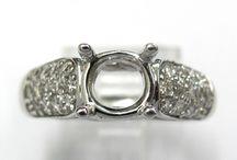BRIDAL: SEMI-MOUNTS / Engagement ring semi-mounts set in 14kt, 18kt and platinum. Set with diamonds, precious and semi-precious gemstones.