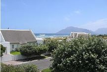 Long Beach Villa / Under romantic thatch - this beautiful home is a stone's throw from world  renowned Longbeach , in Kommetjie.  The  lower floor has two bedrooms, one full bathroom, lounge, dining room and kitchen leading onto a lovely  entertainment area - which has a swimming pool, deck, garden and braai.