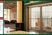 Security Grilles 678 Series / This model is a manually-operated side-folding full-closure grille, available in four separate curtain insert materials for both standard and wide-body configurations. Tempered glass is the standard insert for this series. The curtain frame and panel