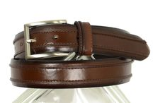 Boys Belts / Don't get a belt to just hold up your pants. Belts are an integral part of finishing your new outfit the right way . All leather belts of glazed cowhide or textured grains in a variety of silver buckles are available.  In most cases a size larger than the actual waist measurement is the way to go. Look to match the color/texture of the shoes.  Look out for all the looks you will get as well.