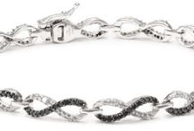 10k White Gold Black and White Diamond Infinity Bracelet (1 1/2 cttw), 7""