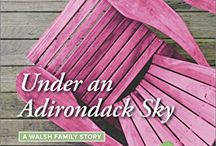 UNDER AN ADIRONDACK SKY (A Walsh Family Story) July 2016 Harlequin Heartwarming / After raising his siblings & running the family pub for a decade, Aiden Walsh has set his own dreams aside until a beautiful woman stumbles into his bar & his arms. Too bad Rebecca Day is the school psychologist in charge of his brother's future. Who's he kidding? He doesn't have room in his full life for romance anyway. But forced to join Rebecca & her group of troubled teens on an Adirondack retreat, he realizes keeping his family afloat isn't enough for him…not by a long shot. / by Karen Rock
