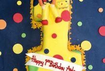 Mr Tumbles number 1 shaped cake