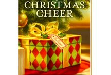 """A Cup of Christmas Cheer, Vol. 4 / """"A Bloom in Winter""""--a present day Christmas short story included in A Cup of Christmas Cheer, vol. 4.   Maggie needed a cheap, safe place to live while finishing her graduate work. Alicia  had an empty house and needed a renewed purpose. Neither imagined how much they needed one another."""