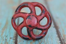 Iron Drawer & Cabinet Knobs / Iron knobs are a great way to add a color and a vintage charm to furniture. These cast iron knobs will last forever and come in charming designs and lots of colors.