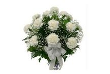 Buy Colourful Carnations Online and Sens it to Bhubaneswar,India / An aura of class and style comes with this collection of 12 white carnations with seasonal fillers hand tied with a rafia or ribbon bow in a glass vase.