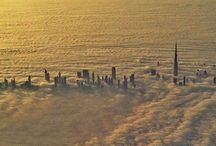 skyscrapers above the clouds