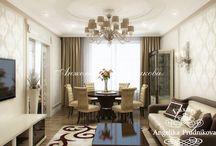 Дизайн квартиры в классическом стиле в ЖК «Английский Квартал» / Анжелика Прудникова создала проект просторной и уютной квартиры в классическом стиле для ЖК «Английский Квартал». В апартаментах гостиная соединена с одной из обеденных зон, рядом имеется вход в кухню – столовую. Интерьер выполнен в каноне классицизма, но в современном прочтении. В дизайне встречаются оттенки бежевого, коричневого и белого цвета.