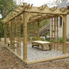 Coleman-Dias³ Construction Inc - Pergola with bench seats / Pergola was built to provide a private reading space. Matching hand built bench recliners provide a place to sit in this cozy reading space. Vines and plants will be planted to grow over the structure providing privacy.  / by Coleman-Dias³ Construction