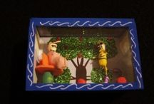 Day of the Dead Dioramas / The Dia de Los Muertos dioramas are miniature skeleton scenes enclosed. These mostly fun and festive scenes are created with clay and hand painted. They are enclosed in a wooden painted box with a glass cover.