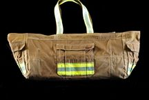 Bags / A unique collection of bags made from recycled fire turnout gear. Current patterns include yoga, messenger and a baby/diaper bag.