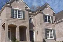 Grey Brick Exteriors / Homes where the combination of brick, mortar and trim create an dominant grey effect.