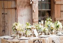 Earthy Romantic Wedding / Natural materials (linen, hessian, cotton), green foliage and silver or cold candle ware make for a romantic feast. Add wrought iron accessories for a classic French Provincial look or wooden chairs for a more rustic feel.  Suspend ivy and white candelabras from the ceiling to complete this classic look