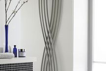 Vertical Radiators / Designer Radiators provide so much more than heat, they are a chance to turn up the style in any room.  Add another dimension to your room with the visual simplicity of a vertical radiator.