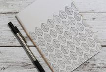 Minimalist Notebooks / Each notebook is handmade, inspired by my lovely country, Sweden. The cover is a print of my own patterns. The bookbinding is handmade as well :)