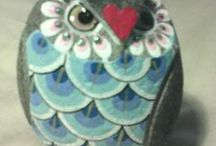 Painted owl on rock