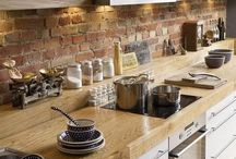 beautiful kitchens and dining rooms / natural wood, brick wall and lots of white with copper accents
