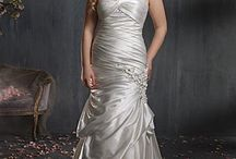 Plus Size Dresses / by WeddingDresses.com