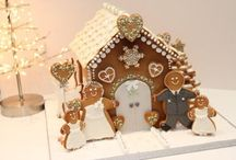 Cookies & Gingerbread Houses / I'm totally in love with the new and unique ways cookies are being decorated. And I have a long-held fascination with gingerbread houses. This is board where I can combine two of my favorite things. / by Tina Socarras