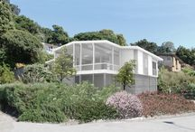 """House for an Architect / Extensive remodel of an existing mid-century house in Sausalito surgically removes problematic and unsightly elements, while maintaining the critical lines and concepts of the original house. The design also transforms the experience. The project also created Sausalito's first Accessible and Affordable """"Additional Dwelling Unit,"""" under the main living space."""