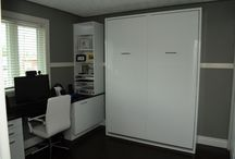 Mark's Home Office/Guest Room- High gloss white cabinets and a murphy bed!! / This custom built, multi-functional space is brilliant! Turn your office space into a guest room or your guest room into an office space…murphy beds! La Cuisine Kitchen Cabinets...Your Style, Our Craftsmanship, Shared Pride!