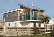 Shearwater / A replacement dwelling of timber frame construction with an open plan and upside down layout to make the most of the sea views on the west cost of Anglesey.