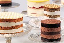"""Naked Love / By undressing the traditional layered cake, our line of Naked Love Cakes proves the """"icing on the cake"""" is just as good on the inside. We've exposed the cakes natural beauty while treating you to layers of delicious filings."""