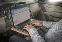 In-vehicle desks / We'd never really encourage doing sustained work in your car or van, but if you can't avoid it, these desks could help make it more comfortable. They lift your laptop / tablet off your knees and should reduce poor neck posture.