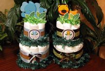 Baby Shower Diaper Cake Centerpieces / These diaper cakes are so adorable, perfect gifts for expecting moms, and terrific centerpieces for your baby shower. Use 15% off with code PINTEREST15 at www.LMK-Gifts.com