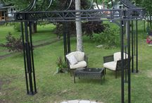 Steel Landscape Structures / Custom fabricated iron landscape structures including gazebos, pergolas, arches and furniture by Babin Ironworks in North Bay, Ontario.