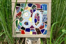 Mosaics by James E. Feiner / James E. Feiner (Jim) creates mosaics from repurposed materials on Martha's Vineyard. As a hobbyist Jim creates artwork for friends, family, colleagues and community members. When closing a property for Feiner Real Estate, he has been known to personally craft a mosaic for new home owners he has had the pleasure of working for and with. This is often their house-number or family name. Beauty is in the details at Feiner Real Estate!