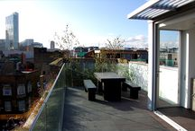 SHOREDITCH - Urban Roof Gardens / SHOREDITCH: In conjunction with Form Design Architects, we developed the flat roof on this spectacular concrete and glass contemporary building into a stunning roof terrace. The area surrounding the new rooftop study was covered in Welsh slate, on which we installed modern terrazzo furniture, reflecting the solidity of the overall design. We softened the contours of the space with a gorgeous selection of grasses and birch trees.