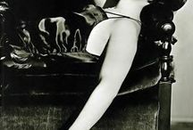 """Louise Brooks / Louise Brooks might be considered the ne plus ultra of the """"flapper"""" girl of the 1920s, almost the archetype of the look.  Usually seen in a close-cut bob of black hair, sometimes in men's clothes, always cool and detached; Louise wrote her own rules until her star fell in the 1930s.  She experienced a renaissance of attention in the 1970s, and became a noted film writer."""