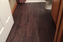 Luxury Vinyl Tile / This homeowner chose to update their existing flooring with Invincible Luxury Vinyl Tile.  The natural wood tones blend in beautifully with any existing woodwork.  Don't be afraid to contrast!