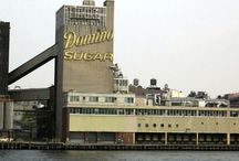 NYC Preservation: Domino Sugar Factory Brooklyn / Built in 1856, the Domino Sugar Factory is a New York City architectural icon that dominates the East River waterfront of Williamsburg, Brooklyn. It was the first of many sugar refineries that contributed to the emergence of the Port of New York as the industrial center in the nineteenth century. By the turn of the century over half the sugar in the world was produced in Brooklyn.