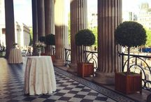 Portico Terrace and Foyer / With unrivalled views overlooking the iconic Trafalgar Square, the Portico Entrance is an extraordinary event space with an exquisite black and white mosaic floor. It is ideal for a summer drinks reception or alfresco dining experience on the external terrace. No need to worry about inclement weather plans with Central Hall serving as an ideal wet weather option. Reception capacity: 60 | Dinner & Breakfast capacity: 100