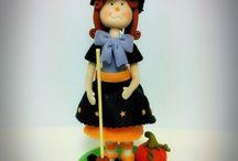 Modelado de bruja Halloween  / Modelado realizado a mano de fondant de varios colores con cmc. Para más información mem@memcakesandcookies.com Visita www.memcakesandcookies.com