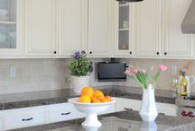 white cabinets/black countertops