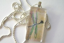 My Original Art Pendants / I began creating wearable art pendants after years of hording scrap wood pieces, scrap papers and other seemingly useless stuff that--for some reason--I couldn't throw away. Then a few years ago I happened upon the fast growing do-it-yourself jewelry aisle at my local art supply store and this discovery led me to creating wearable art jewelry. Whether hand painted, wood burned or decoupaged with prints of my original artwork my art pendants, charms and pins are unique, original and fun!