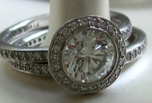 Halo and cluster style rings / An engagement ring inspiration board featuring both diamond and other gemstones