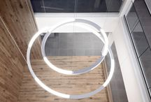 HOLA/HOLA MEETING   Exenia Lighting / HOLA   PENDANT-CEILING LAMPS   Exenia Lighting. Suspension lamp with LED light source for direct/indirect light emission. Body in extruded aluminum in matt white or matt black varnish. The indirect light version includes alternate light modules.