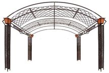 Pergolas & Arbors / These look so cool at nigh and keep you cool during the day.  If you have space in your backyard get one.  You can even get a pergola that plants will grow up, and around the top and sides...really cool.