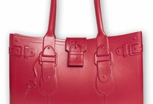 Model M. - RUBY (red) / She's not just the 'it' bag of the season, she's a modern classic.  Fabricated of Fashion-Flex™—a proprietary polymer—Model M. withstands any fashion forecast. Model M. is stylish, resilient, light-weight, and patent-pending. The easy-to-wear construction gives the handbag a sculptural silhouette that never slouches. In sixteen vivid colors—Model M. is a head-turner, just like you.  #SwingOneToday! https://greatbag.co/collections/model-m-classic/products/model-m-ruby