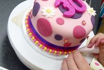 Cake decorating classes / We have a small private class room within our shop at Bishops Stortford where we hold our cake decoating classes and demonstrations. Karen is a fully qualified professionally cake decorator working firstly within the bakery industry for 10 years before opening her first shop in 1987 and in that time she has baked and decorated thousands of celebration cakes and hundreds of wedding cakes. Karen is also very proud to say that she is a recently approved PME tutor.