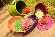 Moonj Baskets / Moonj grass is a wild grass that grows in arid places like eastern Uttar Pradesh, Rajasthan in India. The production of these hand crafted products is time consuming & laborious. This craft has been passed down from generations and is being constantly updated & adapted to suit the modern consumer needs. This green basket can be used for keeping newspaper/ magazine basket or as planters or as trash bins. Adorn your room with these bright colored baskets to make it come alive.