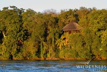 The River Club - Zambia - Wilderness Safaris / On a magnificent bend on the Zambezi River the majestic River Club and its 11 well-appointed chalets have commanding views over the river into the Zambezi National Park.