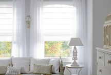 dressing Up windows in Dubai / Roman Blinds perhaps