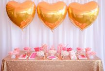 Romantic Pink & Gold Wedding / This wedding decor was simple and chic. White tablecloths with gold tiffany chairs, beautiful soft pinks and rich burgundy florals complimented gold mercury tealights and floating candles. A beautiful Dessert Bar on gold sequin and an array of pink-hued sweets and custom chocolate wraps. Finished with gorgeous gold love heart geronimo balloons for that fun romantic element to the dessert table. Wedding Reception Ideas. Youtube: http://www.enchantedempire.com.au/romantic-pink-and-gold-wedding/