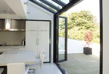 Folding glass facades