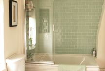 Our Country Cottage Bathroom / The little bathroom is our country cottage has got some lovely features; beams over the windows and country cottage style. But we've added sea-green glass metro tiles to bounce the light around and brighten the space. It offers a good mix of contemporary bathroom style in a more traditional setting.